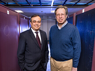 Two businessmen in office hallway